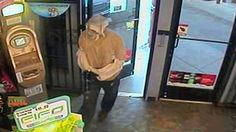 A man wearing plastic bags on his head and arms robbed a convenience store.