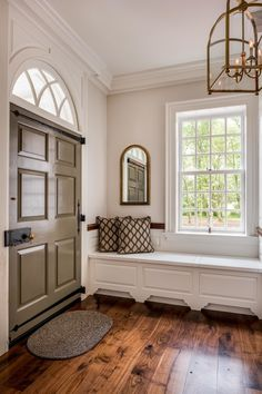 Most beautiful door ever. Love the box lock and the strap hinges. via Isn't this a lovely entrance foyer? It's new construction too!
