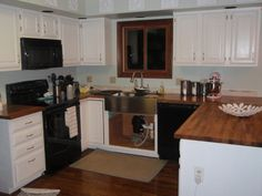 butcher block countertops and apron front sink | Butcher block countertops with stainless apron front sink.