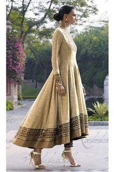 This glittering textured khadi fabric anarkali dress is in beige color. The yoke portion of the suit Anarkali Dress, Anarkali Suits, Punjabi Suits, Kurta Designs, Indian Attire, Indian Wear, Pakistani Outfits, Indian Outfits, Khadi