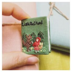 """【marron_embroidery_artist】さんのInstagramをピンしています。 《◇picturebook brooch As a birthday present for my little friend who loves to play """"Little Red Hood"""" ...as a hunter😆📖 . 赤ずきんちゃんごっこにはまっている、おちび友達4歳への誕生日プレゼントへ。 お気に入りは猟師役😆 . . marron−shishu.com . ©︎Marron All rights reserved. No part of my works or photos may be reproduced in any forms without permission from Marron.  図案、写真共に無断使用、商業利用禁止。  #刺繍 #刺繍アート #刺繍絵画 #刺繍イラスト #イラスト #童話#絵本#イラストレーター #イラストレーション #森 #赤ずきん #ファンタジー #ブローチ#ミニチュア#embroidery…"""