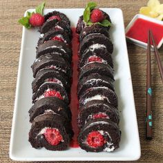 Raspberry Sushi Sweet raspberries and cheesecake wrapped up in a lightasair chocolate cake roll Serve with raspberry sauce driscollsberry Dessert Sushi, Fruit Sushi, Candy Sushi, Sushi Sushi, Tolle Desserts, Köstliche Desserts, Great Desserts, Delicious Desserts, Dessert Recipes