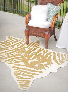 Make a gold DIY faux zebra rug for under $60 using faux suede and metallic craft paint.
