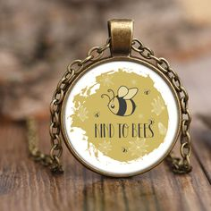 Do you love bees? Show your support for a bee friendly environment and save our ecosystem by saving the bees by buying one of our save the bee necklaces.    Bee Facts: The buzz that you hear when a bee approaches is the sound of its four wings moving at 11,400 strokes per minute. Bees fly an average of 15 miles per hour.