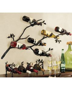 Give a hint of artistry to your wine storage with a wall-mounted wine rack like this one. Get it here: http://www.bhg.com/shop/pottery-barn-branch-wall-mount-wine-rack-p505c392682a71c80fdfde08e.html