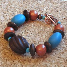 This bracelet is 25% off during my Spring Cleaning Sale!  Turquoise and Copper Handmade Polymer Clay Beads with Wood and Copper