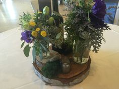 Rustic Wedding with Wood Bases, Jars, Moss and Mercury Votive Candles