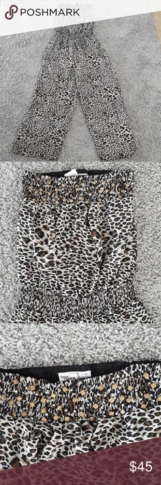 Indian Tropical Fashion Leopard Print Pant Romper Indian Tropical Fashion Leopard Print Pant Romper Size L/XL  Elastic at the top and waist, see through chiffon legs, and beaded detail at the top Tiny imperfection where a hole was repaired but not very noticeable at all.  This is a small Boutique company out of Miami only a few of these were made Indian Tropical Fashion Pants Jumpsuits & Rompers