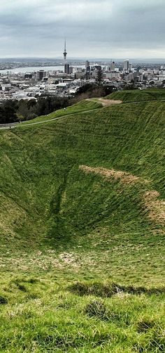 Auckland City and Mount Eden crater - Auckland, NZ (Sheep sometimes graze these slopes, and people walk within this crater too).