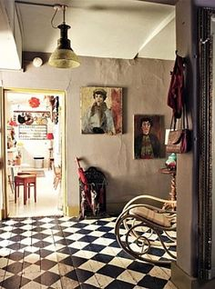 Checker board floor in antique dealer's home.