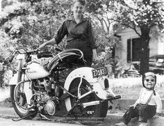 The photo above appears to have been taken down south as the Harley-Davidson Panhead is wearing a 1957 South Carolina license plate. The child's cloth helmet, sunglasses with white plastic frames, and the suspenders make the image. Just imagine how excited he must have been to go for a ride on that big machine.