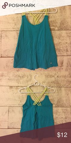 Teal and yellow strappy workout shirt Only worn twice. Adorable workout shirt from forever 21! Has a large slit in the back to show the lower back! Make me an offer!:) Forever 21 Tops Tank Tops