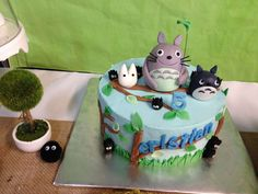 Adorable cake at a My Neighbor Totoro birthday party! See more party planning ideas at CatchMyParty.com!