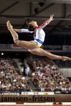Andreea Răducan (Romania) on balance beam at the 2001 World Championships