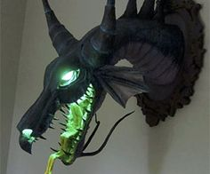 Mount Disney supervillain Maleficent's head on your wall!- Mount Disney supervillain Maleficent's head on your wall! What better trophy than the glowing green noggin of the world& most fearsome villain (Sleeping Beauty& Maleficent) in dragon form? Maleficent Dragon, Disney Maleficent, Maleficent Party, Maleficent Cosplay, Disney Disney, The Meta Picture, Creative Lamps, Gothic House, Gothic Room