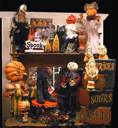Bethany Lowe figures mixed in with stacking Halloween cake plates and stackable boxes.
