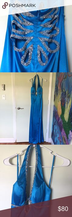 Blue evening gown Purchased from Cache. Amazing beading detail, cut out just below cleavage and on back (first photo). Floor length with slit up to knee on left side. One of the clasps just came loose, I will try to sew it back on before shipping. Accepting all reasonable offers. Can ship same day! Cache Dresses Prom