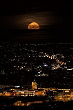 A half of full moon in Budapest (foreground the Buda Castle) - Budapest, Hungary