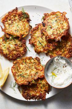 NYT Cooking: Mucver (pronounced moosh-vair) are delicate, crisp zucchini pancake. - NYT Cooking: Mucver (pronounced moosh-vair) are delicate, crisp zucchini pancakes popular in Turkey - Zucchini Pancakes, Zucchini Fritters, Pumpkin Pancakes, Chicken Breast Curry, New Vegetarian Recipe, Vegetarian Kids, Roast Pumpkin Salad, Pasta, Popular Recipes