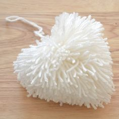 Create a Pom Pom Heart with this easy DIY with the help of something you have hanging around at home!