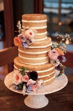 Chic naked vanilla layered wedding cake accented with pretty pink flowers; Featured Cake: The Cake and I