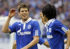 Schalke scorer Klaas-Jan Huntelaar, left, celebrates with Atsuto Uchida after scoring his side's 2nd goal during the German first division Bundesliga soccer match between FC Schalke 04 and SC Freiburg in Gelsenkirchen, western Germany, Saturday, Sept. 24, 2011. The match ended 4-2.