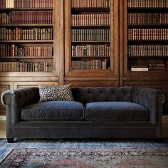 Chesterfield-style Couch, Leopard-Print Pillow & Luxury Library
