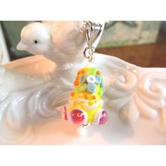 Necklace SALE yellow pink green bell shaped glass art lampwork bead... ($20) ❤ liked on Polyvore featuring jewelry, necklaces, multi coloured bead necklace, beaded chain necklace, multicolor necklace, pink necklace and multi coloured necklace