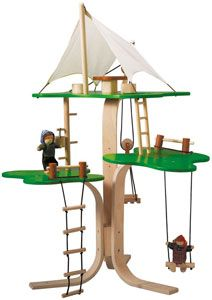 this fanciful tree house has 3 levels on its trunk of curved plywood. the top level has a canvas canopy covering a living area with a table and chairs. there is a working pulley and pallet to hoist objects to the upper levels. the tree house set includes a table, 2 chairs, a bucket, a rope ladder, a swing, and 2 figures.