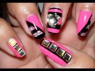If you like a bit of bling then check out this hot pink and black design for your nails!