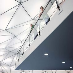 Approximately 390 translucent, triangular, back-lit panels are suspended from the ceiling's steel structure.
