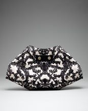 Shopping for a new clutch this year...and found this lovely piece -Alexander McQueen De-Manta Lace-Print Clutch