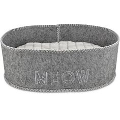 Keep your kitty comfy with the charming and playful Harmony Grey Felt Cat Bed. Its faux fur cushion features stylish textured stitching and a supportive polyester fiber fill.