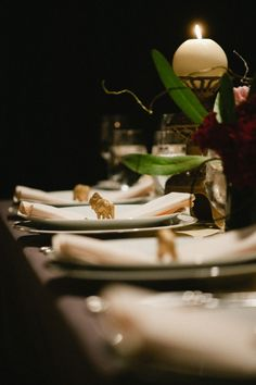 """""""My very favorite part was the little gold animals we put on each guest's plate. My awesome new sister-in-law spray painted about ten thousand plastic animals for me. My lovely husband used a laser cutter to carve escort cards out of wood for everyone. We love Lord of the Rings, so we used a hobbity font, and then he stained them all fuchsia."""""""