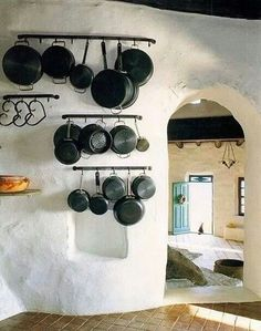 Wall pot hangers and rounded door.