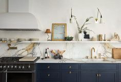 Calacatta Paonazzo marble counters paired with chalky gray cabinetry. The couple collaborated with Elizabeth Roberts on the architectural design. Kitchen Shelves, Kitchen Backsplash, Kitchen Cabinets, Backsplash Marble, Kitchen Decor, Navy Cabinets, Kitchen Ideas, Calacatta Marble, Kitchen Windows
