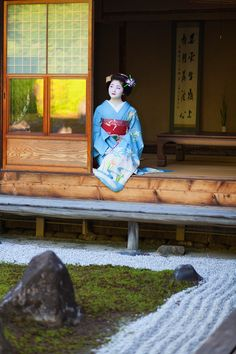 Maiko, Satuki in Japanese tradetional house and garden. Kyoto. Japan.