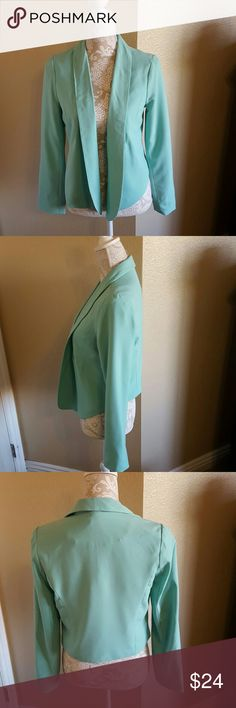 Candie's Mint Green Open Front  Blazer size M Super Cute Candie's Mint Green Open Front Blazer size M. Very figure flattering cut with darting at chest and around waist. Fully lined. Excellent condition. Never wore this is a reposh from one of my very favorite closets cherskloset. Sadly it does not fit me Candie's Jackets & Coats Blazers