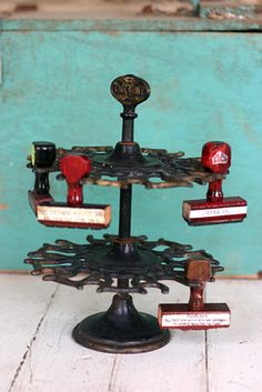 Vintage stamp holder - had one on my desk at a travel agency - filled with stamps on both racks.