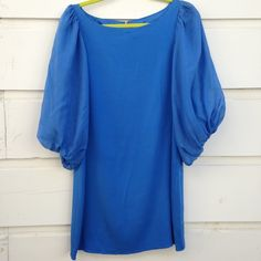 """Alice + Olivia blue dress Alice and Olivia blue dress with with fluffy 3/4"""" sleeves. 100% silk. The tag says size Large but fits like a Medium. New with tags. Best offer. Alice + Olivia Dresses Long Sleeve"""