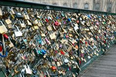 Bridges of Locks in Paris. When you are in love, go there with a lock write you and your partners name on it, lock it on the fence and throw the key in the river.  Symbolizes eternal love.
