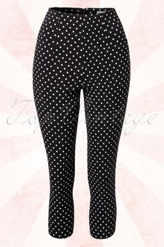 These50s Kay Polkadot Capri Pants in Blackby Bunny are classy pants with sassy polkadots!  Nicely fitted model with flattering high waist and 7/8 legs with a small slit at the back. Made from a lovely stretchy rayon blend in elegant black with playful white polkadots for an amazingly comfy fit. Finished off with a zipper at the back. Pair with classy black and white to complete your look! The featured pumps are not available in our shop