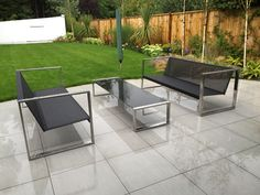 FueraDentro CIMA LOUNGE contemporary garden sofas, on a very wet West Sussex day. The furniture is shown here in electro-polished stainless steel and Batyline synthetic mesh. www.fueradentro.com