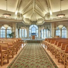 An Elegant Wedding Chapel With Pews Arched Stained Gl Windows And A High Beam Ceiling Chandeliers Pinterest Ceilings