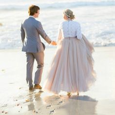 Walking hand in hand along the sand. xoxo @weddingchicks #beach #weddingchicks #photography #maxi #groom #bride