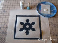 Freezer paper stencils... how cool is this..  and then they make a quilt out of the blocks.. check out the website