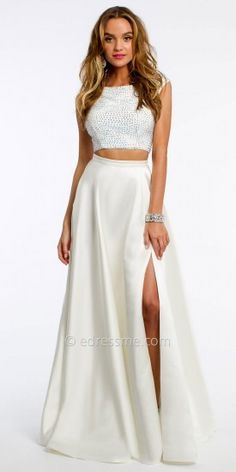 Jovani PROM Embellished Two-Piece Ballgown Prom Dress.  You'll be the belle of the ball in the Embellished Two-Piece Ballgown Prom Dress by Jovani. This glamorous style features a crystal-embellished off the shoulder top with a cutout open back, and a full satin ball skirt with a leg slit. Add drop earrings and a beaded handbag to complete the look.