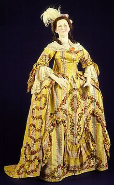 Sack back open robe and petticoat, British, c. 1765-70. Made of silk brocade with linen lining in the bodice, trimmed with passementerie, chenille.