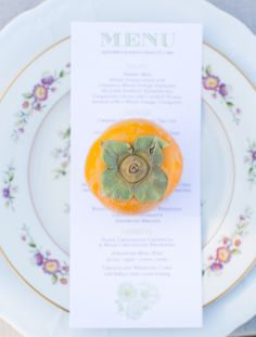 Vintage place settings accented with persimmons | Annie McElwain Photography