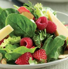 Use your favorite cheeses and dressings in this Fresh Berry Salad. If raspberry vinaigrette is too sweet for you, try balsamic. Strawberries love balsamic vinegar - and we do too!